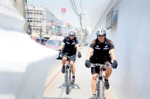 Ayutthaya police on bicycles near temple