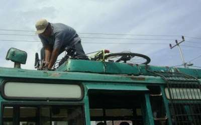 Bicycle on top of bus